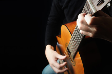 Acoustic guitar player hands Classical guitar close up