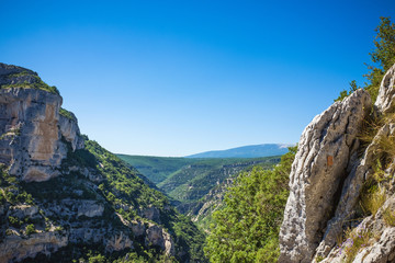 Rocky canyon with trees and blue sky
