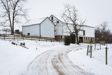 Snow covered road and barn, near Jefferson, Pennsylvania.