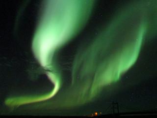 Breathtaking flashing northern lights over Jokulsarlon Glacier Lagoon in South Iceland