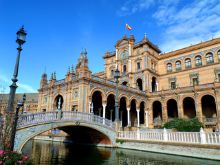 Gorgeous Decorated Tiled Bridge and the Architecture Plaza de Espana against the Vivid Blue Sky, Seville in Spain