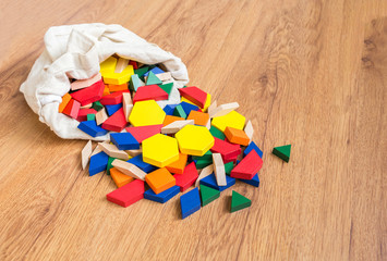 Wooden colored blocks poured out of bag Shallow DOF