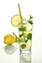 Glass of cold refreshing drink with ice and mint