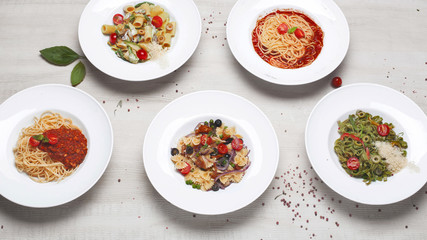 a variety of pasta on the menu of different shapes