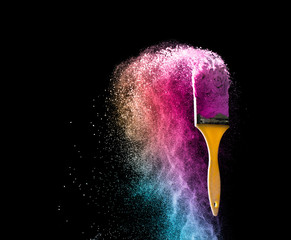 paint brushes with abstract powder color explosion isolated on b