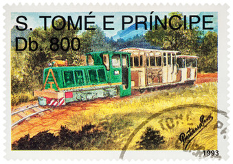 Old small locomotive with wagon on postage stamp