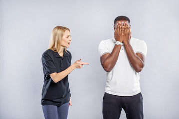 Confused Caucasian woman trying to understand african man
