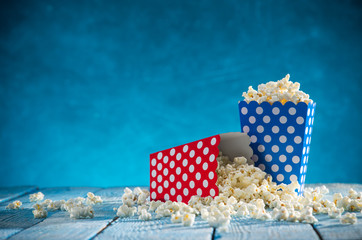 Boxes of popcorn on blue background.