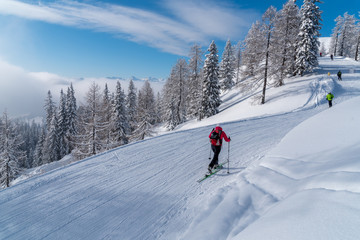 Skiers in Alps mountains