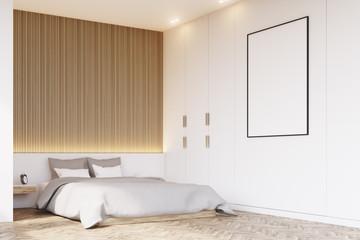 Corner of bedroom with wooden floor