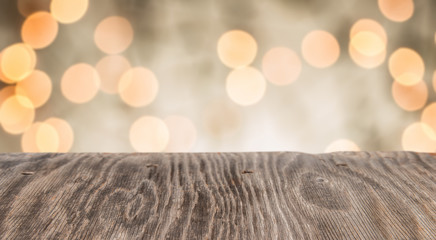 Rrustic wood table in front of glitter and bright bokeh lights