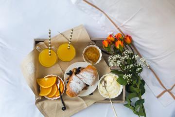 Romantic breakfast with love, croissants, coffee, orange juice