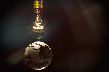 Light bulb and earth