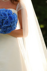 Beautiful bouquet in the hands of the bride in a white dress.
