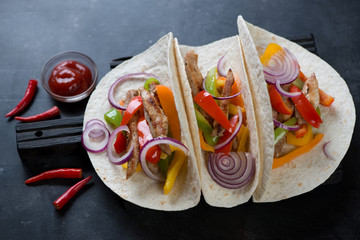 Tortillas with traditional tex-mex pork fajitas, high angle view