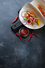 Tortillas with fajitas, scratched metal background, copyspace