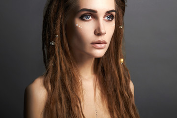 beautiful woman with make-up and dreadlocks
