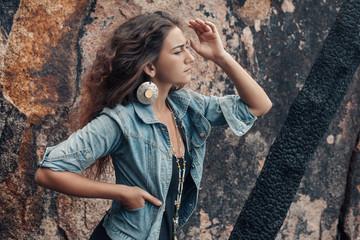 atrractive young woman in denim coat outdoors