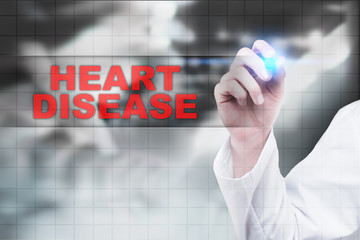 Medical doctor drawing heart disease on virtual screen.