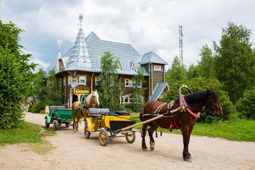 Old carriage in russian tourist center Verhnie Mandrogi