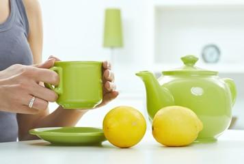 High key pastel still life of tea kettle mug lemon