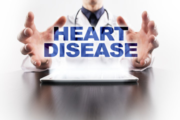 Medical doctor using tablet PC with heart disease medical concept.