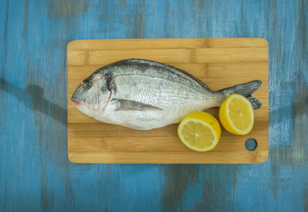 fish delicacy on wooden