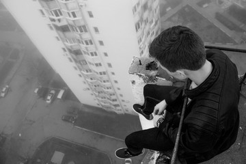 Young man on the roof of suicide