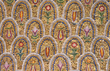 The wall in the temple of colorful mosaic