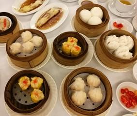 Chinese food in China town, Variety of dim sum set in the local restaurant in china, traditional Chinese lunch meal, dumplings, BBQ pork bun, noodle tube roll in the top view