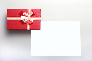 Beautiful gold, red present gift box and ribbons on backgound