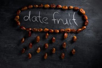 Date fruit over dark chalkboard background