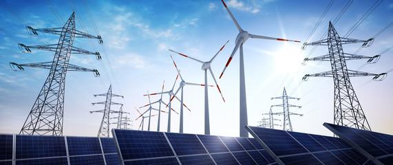 Hochspannungsleitungen mit Solaranlage und Windrädern 3