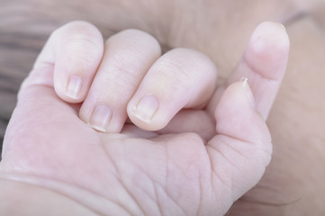 Hand of newborn. Hands of father and son united. Maternity and p