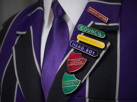 School boys blazer with school numerous badges