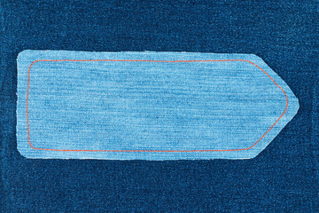 Pointer made of denim fabric with yellow stitching on dark denim, with space for your text.