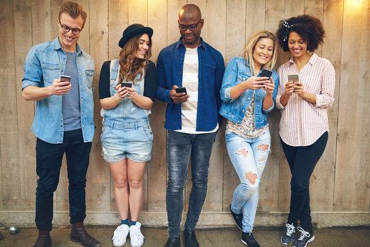 Friends using smartphones
