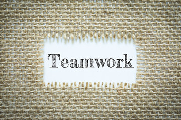 Text Teamwork on paper white has Cotton yarn background you can apply to your product.
