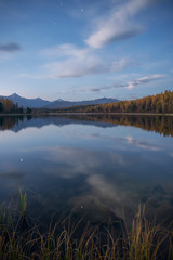 Mirror Surface Lake Vertical Orientation Autumn Landscape With Mountain Range In Early Eveing With Stars On The Sky