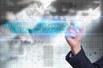Businessman is drawing on virtual screen. digital rights management concept.