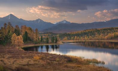 Mirror Surface Lake Beautiful Evening Autumn Landscape With Mountain Range On Background