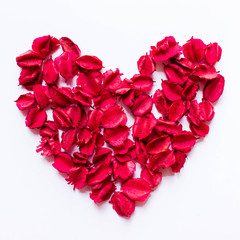 Red dry leavs in the heart shape on white background