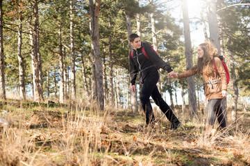 Teenage friends hiking,sunny winter day