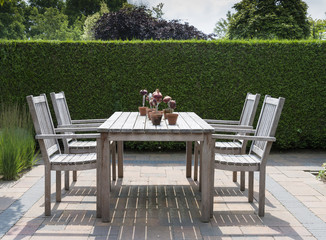 wooden garden furniture in garden