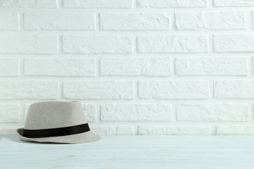 Pretty hat on the brick wall background