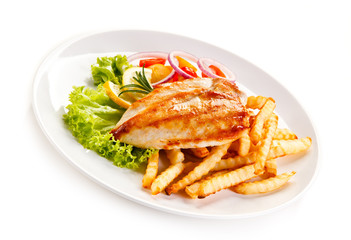 Grilled chicken fillet, chips and vegetable salad