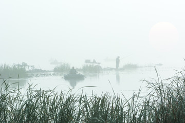 figures of the fishermen in the fog