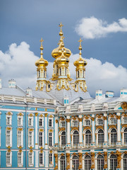 Golden domes grace the top of the chapel at Catherine Palace in Pushkin outside of Saint Petersburg Russia.