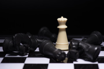 One  chess pieces staying against black chess pieces