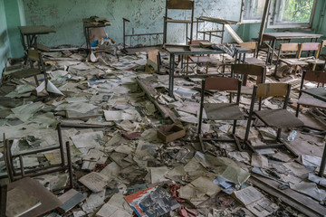 abandoned class room with furniture and debris in Pripyat School, Chernobyl